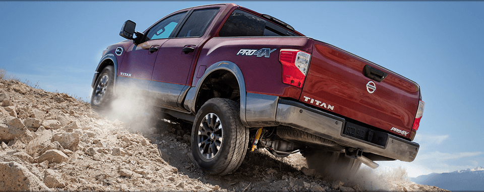 Red 2017 Nissan Titan with Silver Trim, Rear View